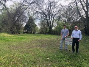 Two Structures Homes Owner Jay Evans and UCO Real Estate Intern Ryan Chapman at the homesite for the Broncho House